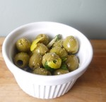 green olives with lemon, oil, sage and fennel pollen