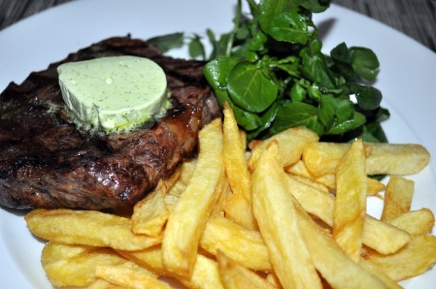 Chargrilled Aged Hereford Rib-Eye Steak, Hand Cut chips, Green Salad, Garlic Butter