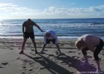 Revival Bootcamp stretching on the beach 1