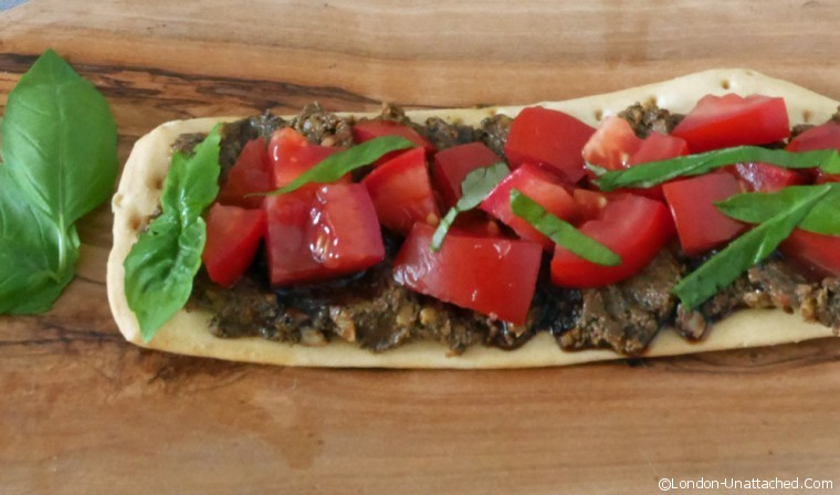 Tapenade on flatbread with tomato salsa
