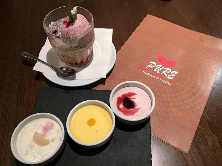 Glass of Falooda with strawberry and three ramekins of mango, lychee and rasberry baked yoghurt