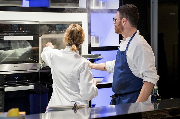 Picture of chefs looking at steam ovens