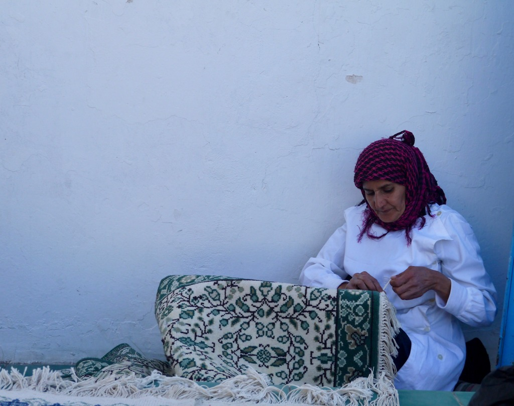 Lady making carpets, Tunisia
