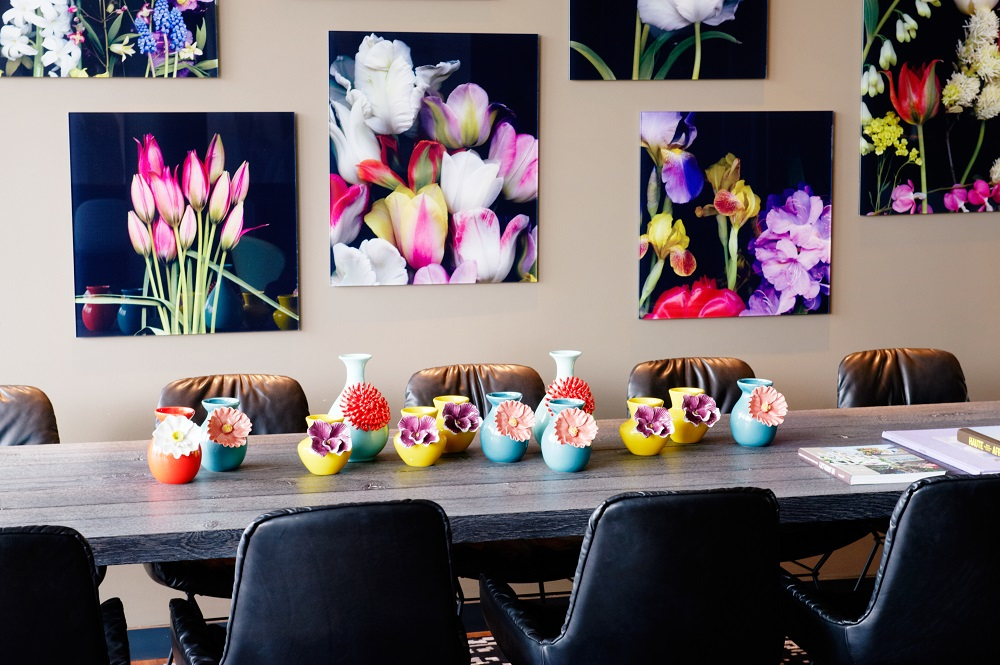 table with coloured vases - Motel One Amsterday