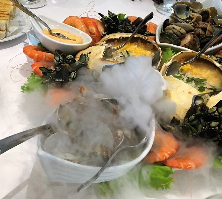 Clams with king prawns, goose barnacles and filled crab shells