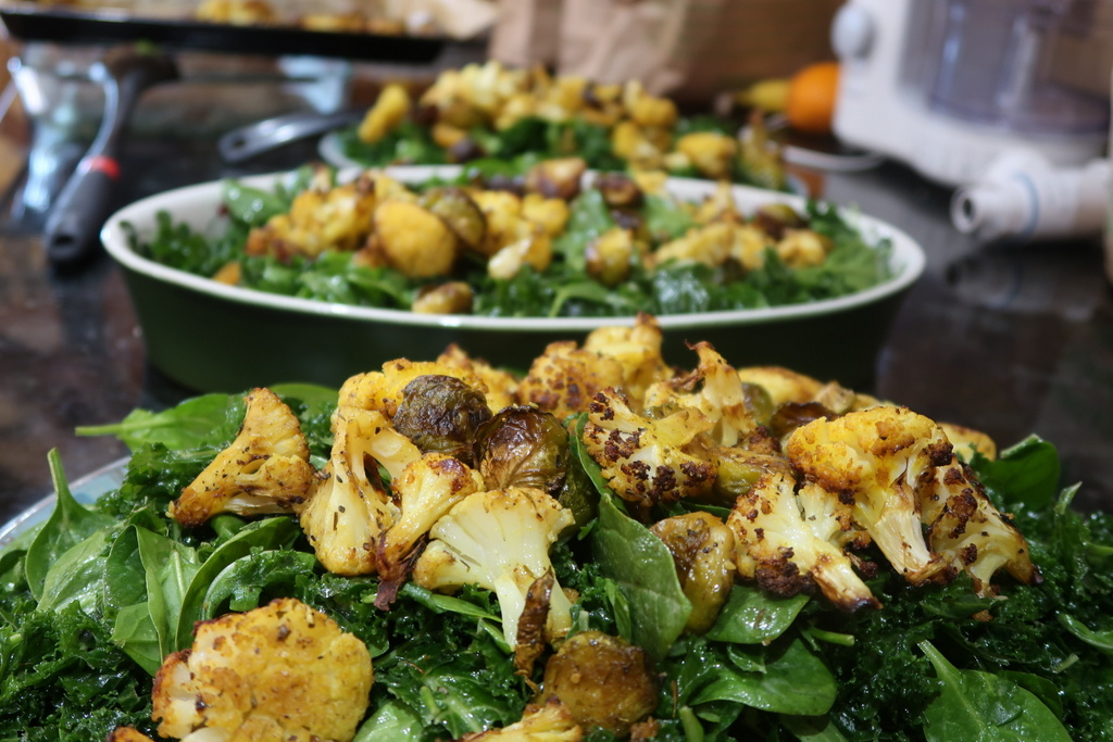 Adventure Yogi - Kale salad with roasted cauliflower and sprouts