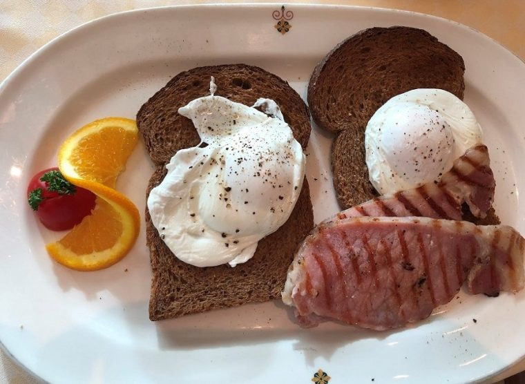 Cooked breakfast of bacon with poached eggs Sabatini's restaurant Royal Princess