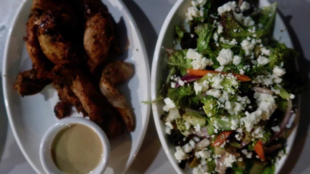 Sand Dollar Café Jerk chicken and salad. pg