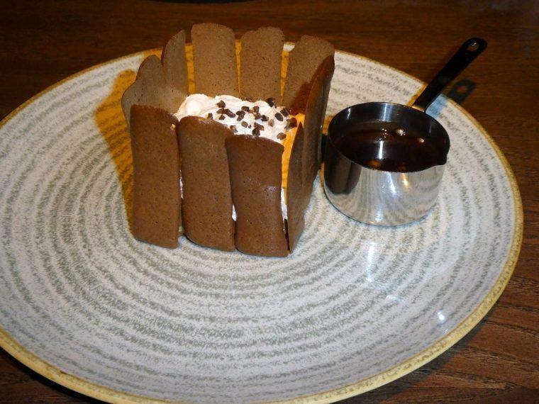 Charlotte with chocolate sauce Heliot Steak House London