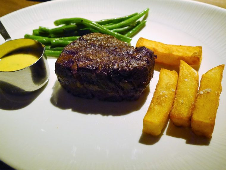 Medium Fillet steak with garlic green beans and triple cooked chips Heliot Steak House London
