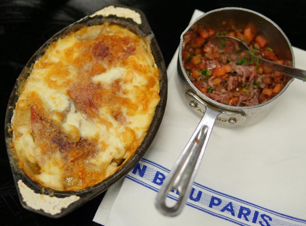 Potato and Parma ham gratin with sauce vierge