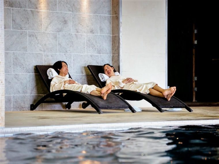 mother and daughter at spa pool