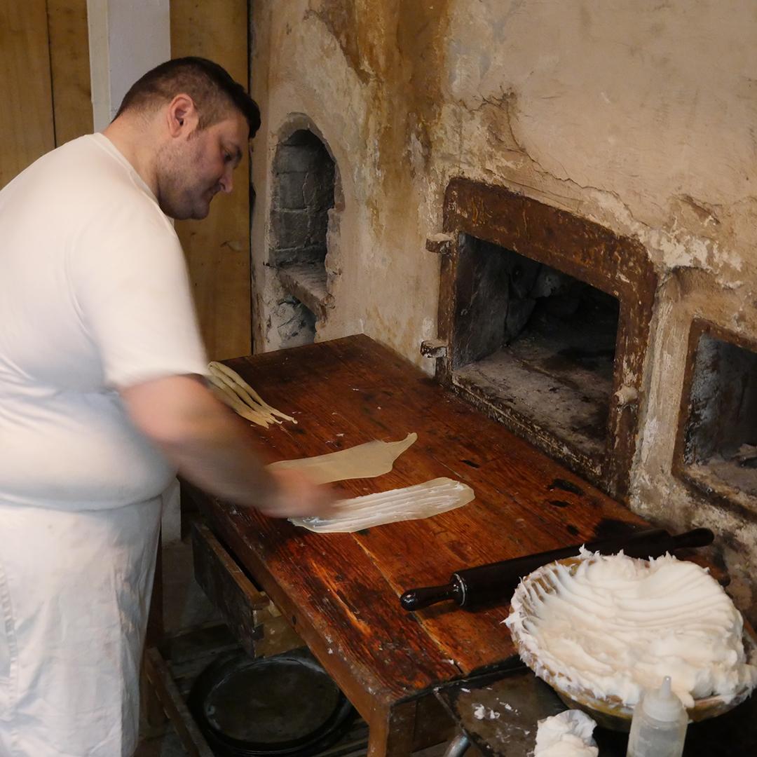 Making Enseimada at Forn de la Soca