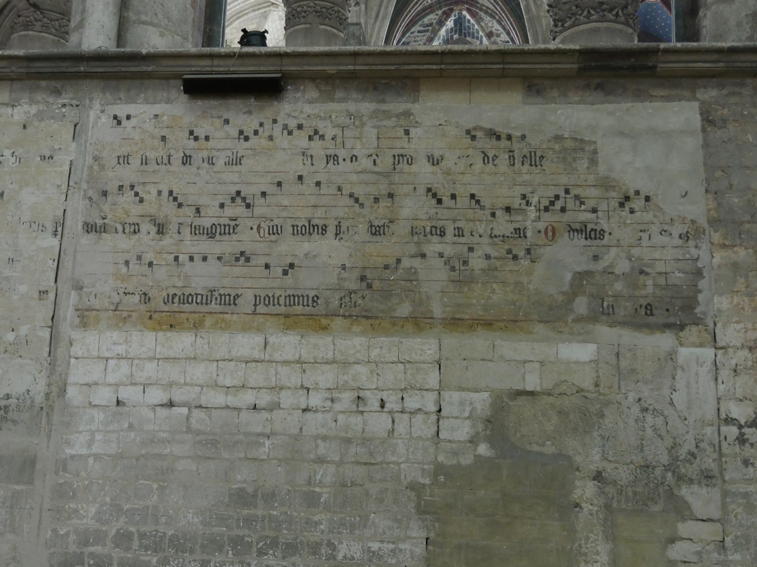 Original plainsong on walls of Cathedral St Quentin