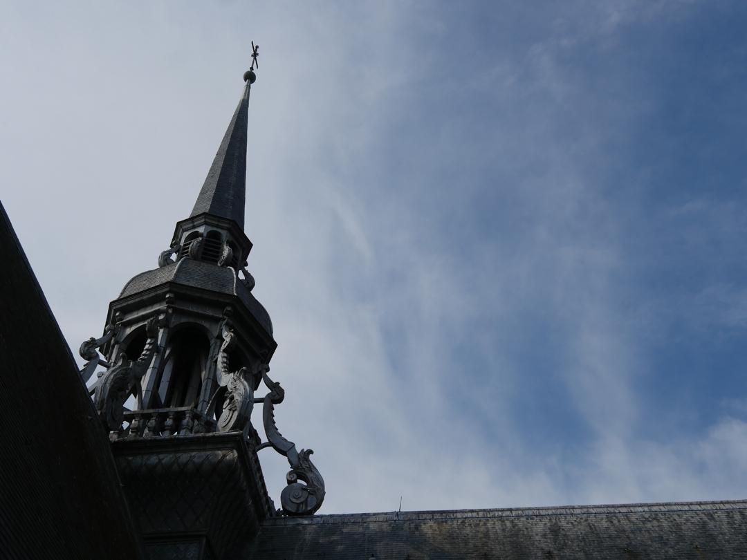 St Quentin Basilica Spire against a blue sky