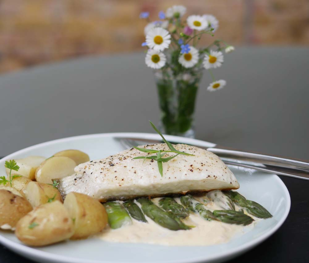 Halibut with asparagus and champagne cream sauce and Jersey Royal new potatoes