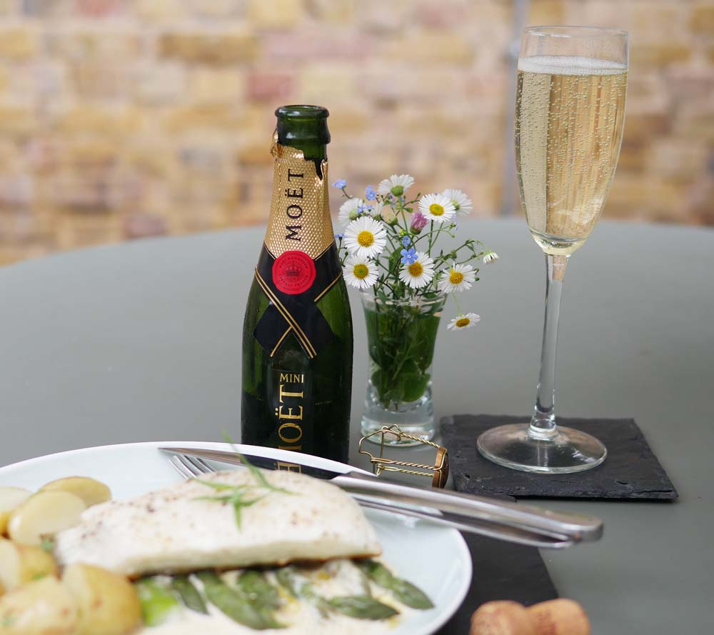 Halibut al fresco with a glass of champagne
