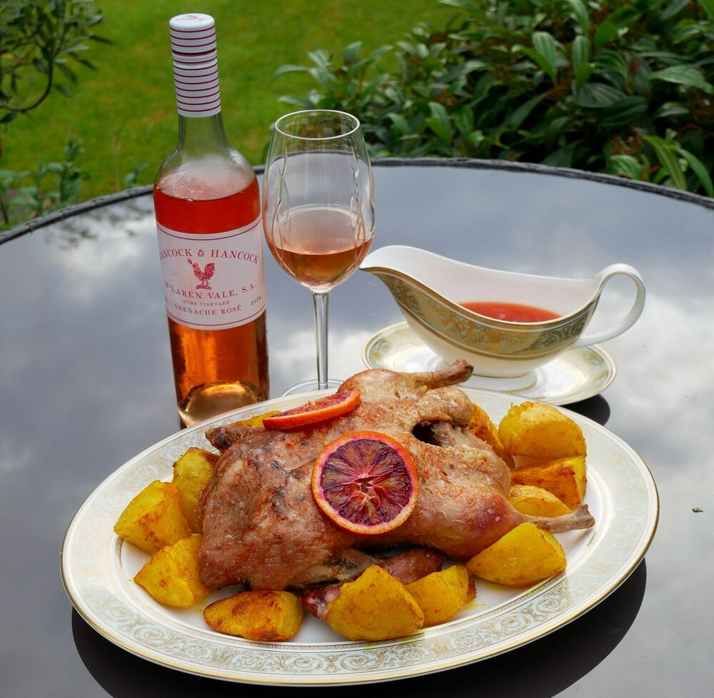 Roast duck with blood orange sauce and Hancock and Hancock rose.
