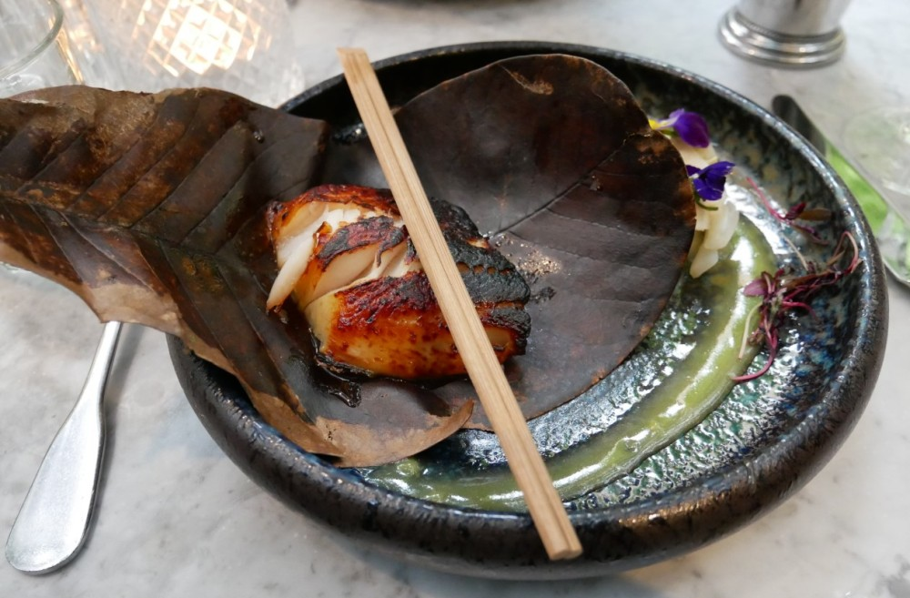 Black cod unwrapped from the leaf at the Ivy Chelsea Garden