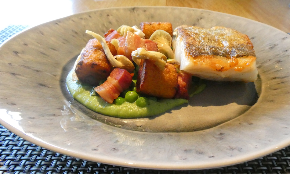 Roast Cornish cod with pancetta, wild garlic, peas and oyster mushroom Old Quay House Restaurant
