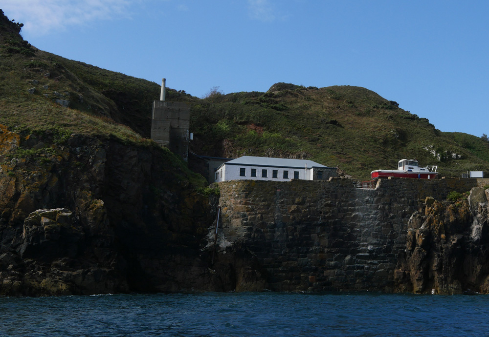 Sark Harbour with telephone mast Chimney