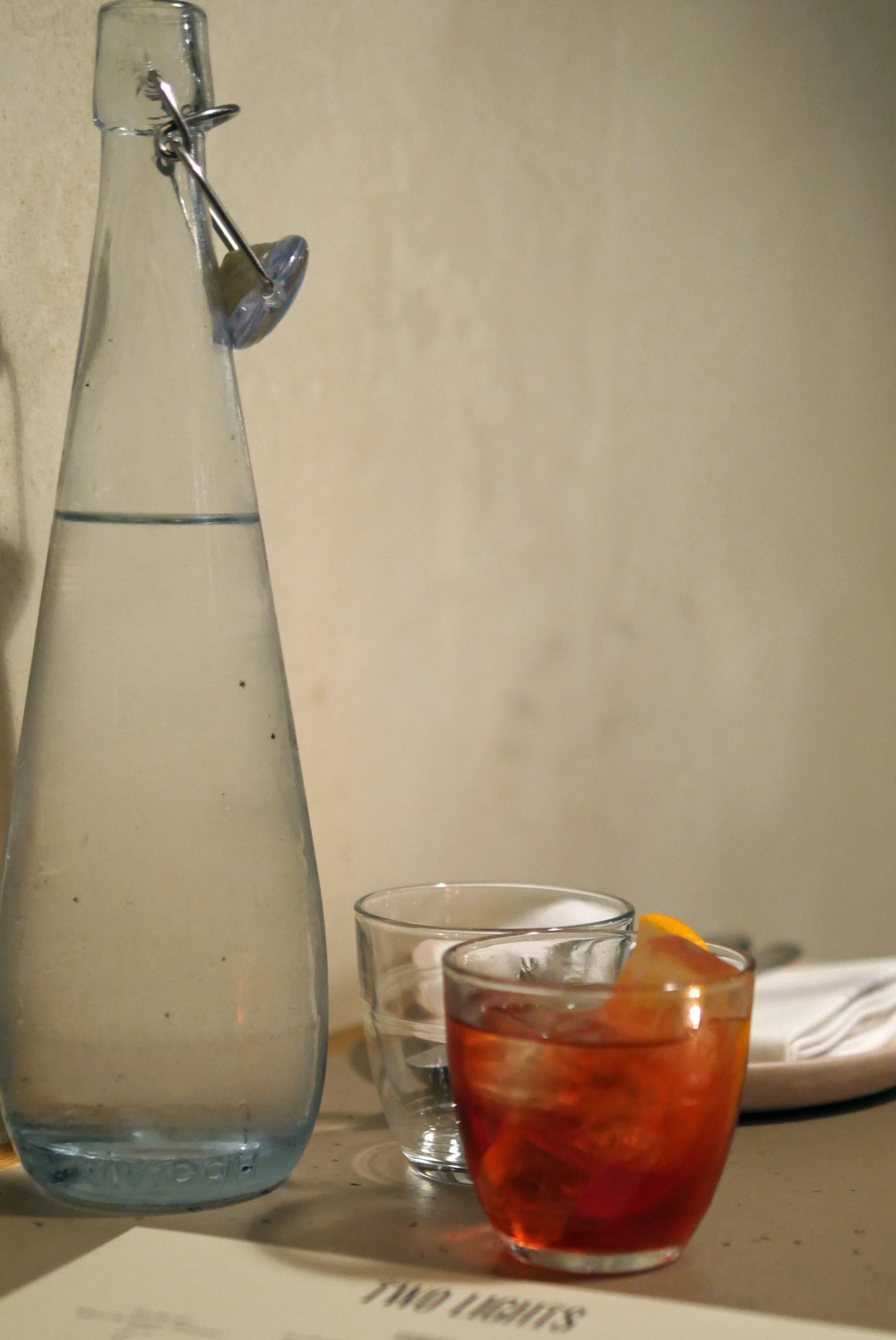 Water and Negroni at 2 lights