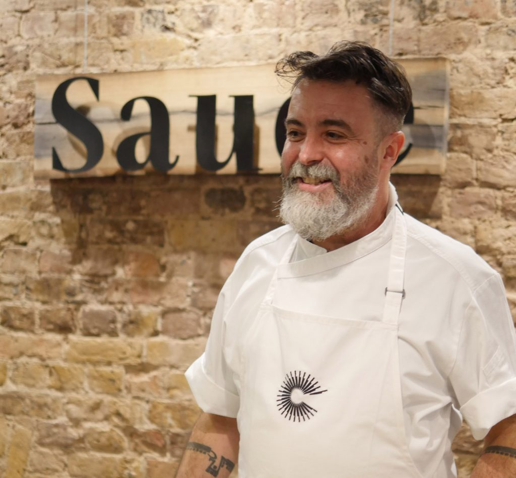 Nuno Mendes at Sauce, Langham Hotel preparing to cook Macanese curried prawns with okra