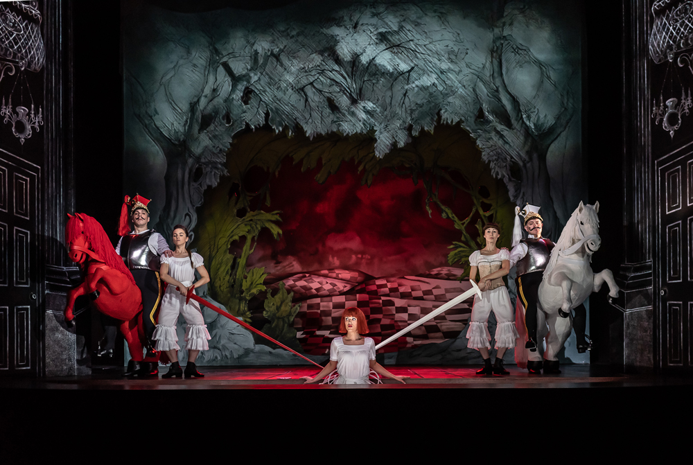 Alice's Adventures Under Ground by Gerald Barry; Royal Opera House; Covent Garden; London, UK; Alice - Claudia Boyle; White Knight/Cheshire Cat/Mock Turtle - Mark Stone; Red Knight/Humpty Dumpty/King of Hearts - Joshua Bloom (left); Conductor - Thomas Adès; Music and Libretto - Gerald Barry; Director - Antony McDonald; Designer - Antony McDonald; Lighting designer - Fabiana Piccoli; Movement director - Lucy Burge; Photo: © ROH photographer CLIVE BARDA;
