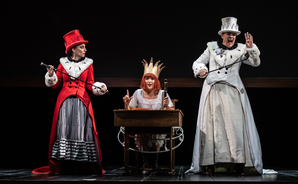 Alice's Adventures Under Ground by Gerald Barry; Royal Opera House; Covent Garden; London, UK; Alice - Claudia Boyle (centre); Red Queen/Queen of Hearts - Clare Presland; White Queen/Dormouse - Hilary Summers(rt); Conductor - Thomas Adès; Music and Libretto - Gerald Barry; Director - Antony McDonald; Designer - Antony McDonald; Lighting designer - Fabiana Piccoli; Movement director - Lucy Burge; Photo: © ROH photographer CLIVE BARDA;