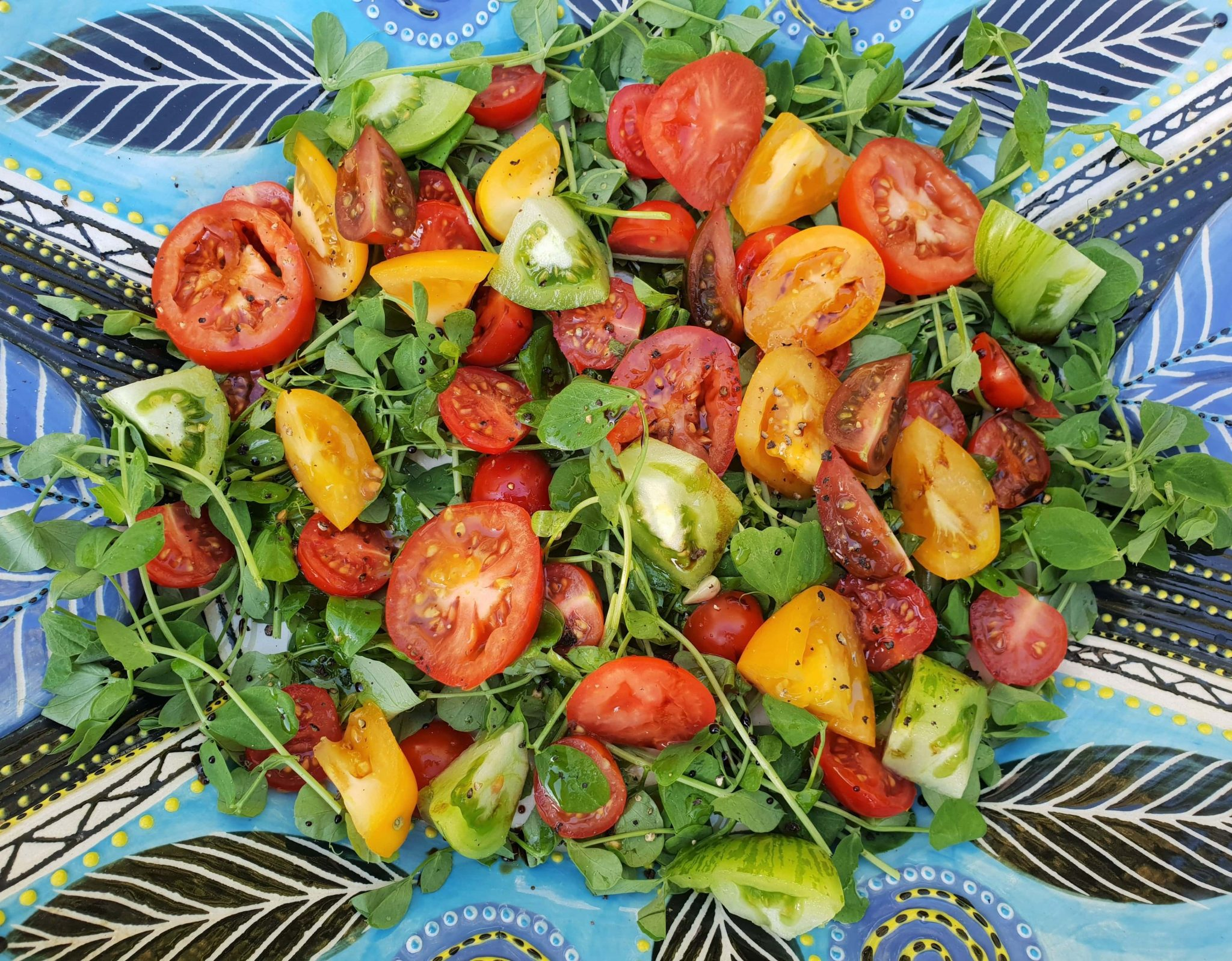 Natures Choice heirloom tomato and pea shoot salad