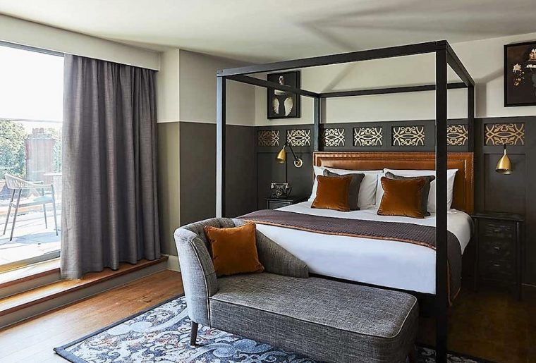 bedroom with balcony at the Hotel Indigo Chester