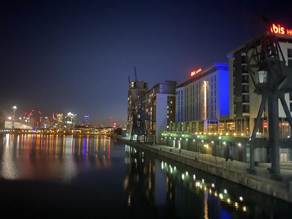 night view across Victoria Docks, London