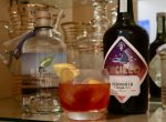 Classic Negroni with Vermouth and Gin bottles