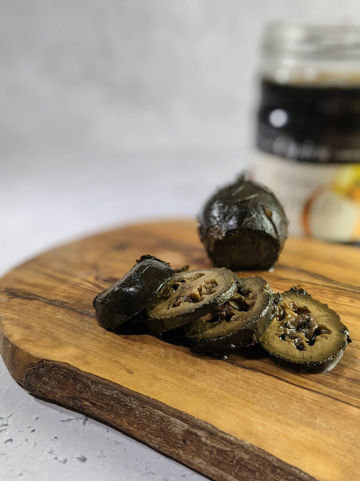 opies pickled walnuts sliced on a board