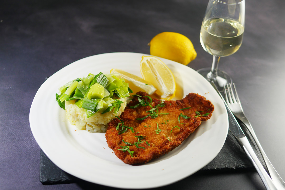 Pork Schnitzel with Smashed baby potatoes and buttered leeks