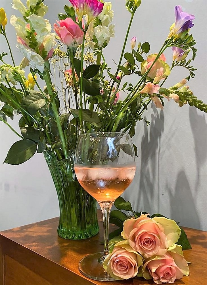 bouquet of flowers for mothering sunday with MOM LOVE branded pink gin and tonic