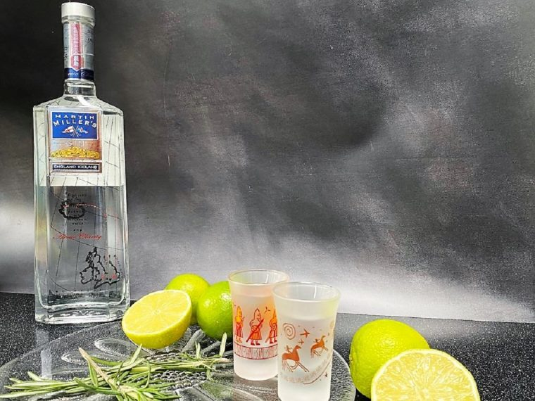 bottle of Martin Miller's Gin with limes and lemons