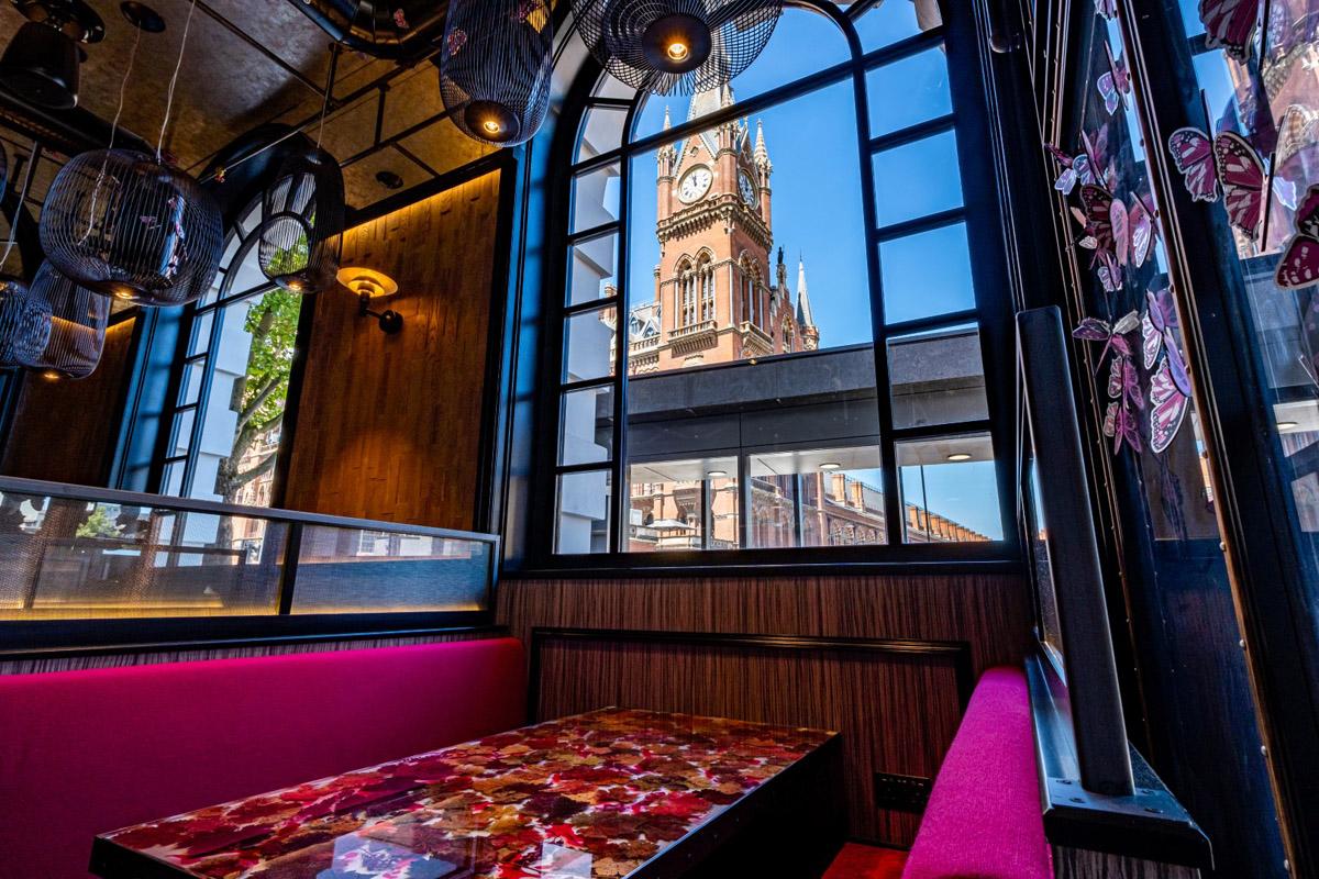 Magenta restaurant interior and table