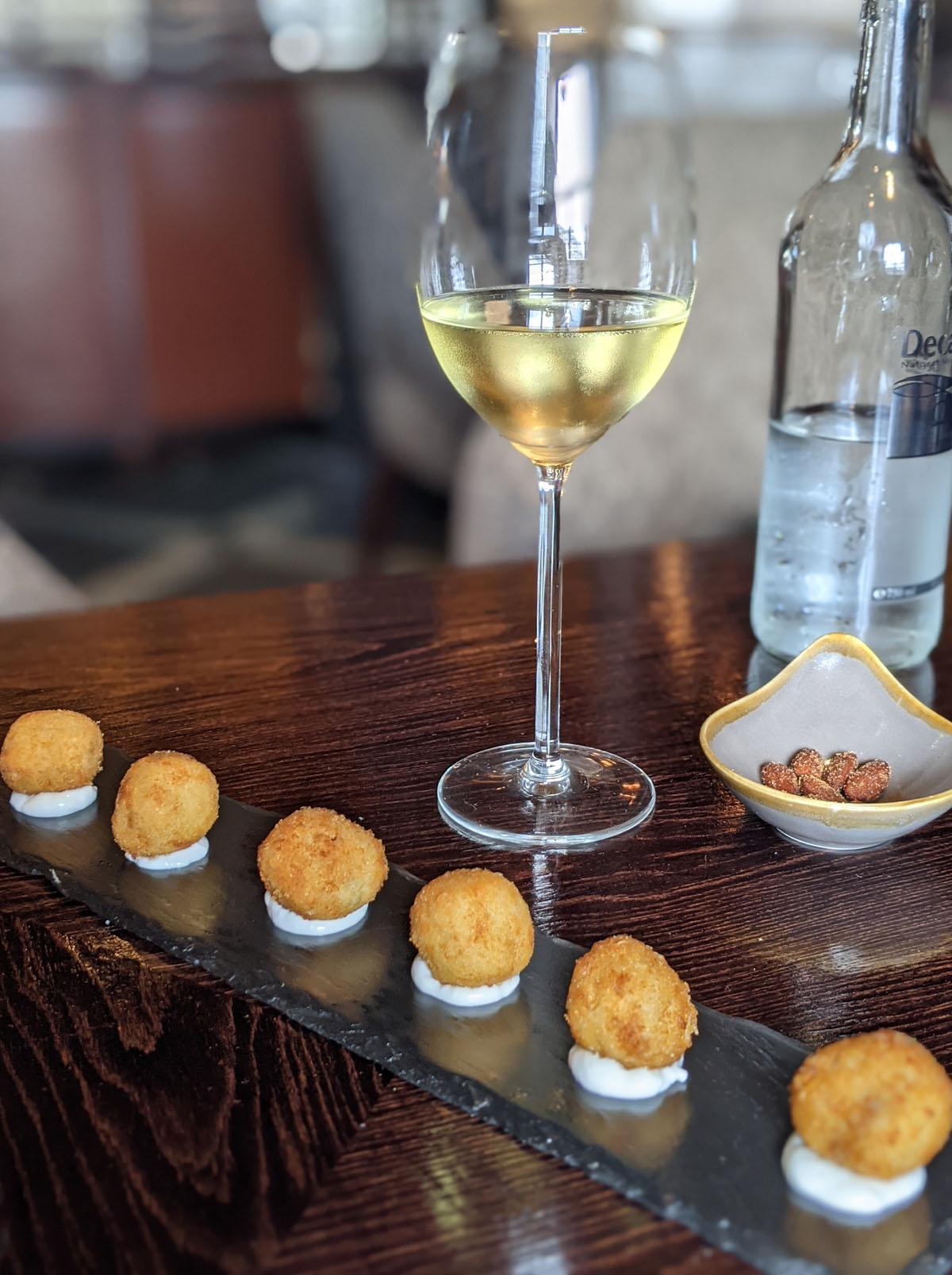 Aqua Nueva wine and ham croquetas